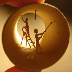 Beautiful miniature paper arts.  With a quirky canvas and steady hand, Anastassia Elias creates fantastic scenes inside empty toilet paper rolls. With the right lighting these scenes burst to life; silhouettes in a land of cardboard.