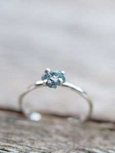 Mermaid Rebel // Raw Blue Diamond Ring This rough diamond ring features an uncut ocean blue diamond prong set onto a dainty silver band. Oh how you'll gush at this raw beauty every single day! This jewel will be so much more than just another piece of jewelry. You'll feel beautiful with these ocean-loving vibes.