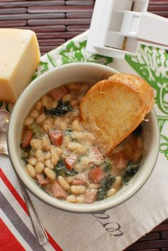 sausage and white bean soup - sounds delish...saving this recipe for when its not 100 degrees out!