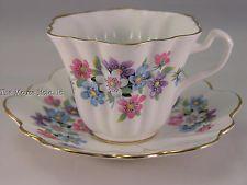 Lefton shaped teacup & saucer w/ pink purple white & blue flowers gold edges