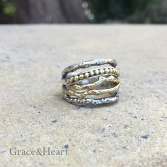 The amazing Lineage Ring.  This was what brought me into this amazing life of Business Ownership.  It's Sterling Silver and Brass.  One of the most comfortable wide band rings I've ever worn.  I get comments on it all the time...love that too.  www.mygraceandheart.com/RhondaMoline