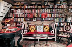 stylishly enveloped by books!  Being an avid reader....this would be my dream room