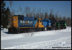 A special 999 powered by GP38-2 1801 hauls locomotives formerly used for switching at the now permanently shut down Resolute Iroquois Falls Mill past mile 1 of the Iroquois Falls Sub February 27th.