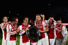 Daley Blind, Siem de Jong, Christian Eriksen, Eyong Enoh, Captain Jan Vertonghen, Dmitriy Bulikin, Andre Ooijer and Miralem Sulejmani of Ajax hold the trophy and celebrate after winning the Eredivisie League title at Amsterdam Arena on May 2, 2012 in Amsterdam, Netherlands.