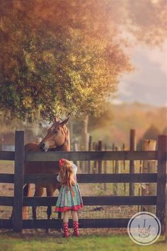 adorable photo session of little girl and horse - country life on the farm