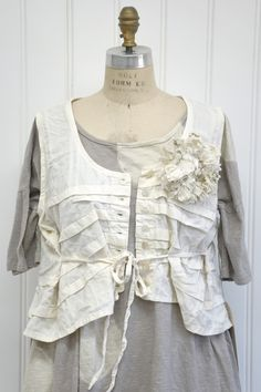 """Features:    Cropped cami/vest   Random tucks throughout   Side ties   Button up style   100% Plaid Cotton Broadcloth, Cream   Fits Sizes 2 to 14   Measurements:    Chest: about 48"""" around   Length: about 19"""" long in the front, about 22"""" long in the back"""