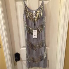 Christina Love NWT slip dress size M NWT cotton shift dress has adjustable bra straps and flapper style beading detail in front only Size M retail tag attached no flaws Christina Love Dresses Midi