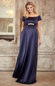 If you're looking for a statement dress then our Aria long midnight maternity gown will guarantee you a show-stopping entrance. In rich navy satinesque fabric that drapes to the floor, the effect is dramatic and eternally stylish.