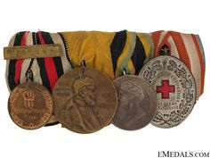 """Imperial German Army Group of Four - Imperial German Army Group of Four mounted as worn, comprising: 1870-71 Franco-Prussian Campaign medal, with """"Pars"""" clasp; Prussian Centenary Medal 1897; Saxony, (unofficial) silvered medal, engraved on reverse; Red Cross Medal, silvered, center enameled; Generally in very fine condition"""