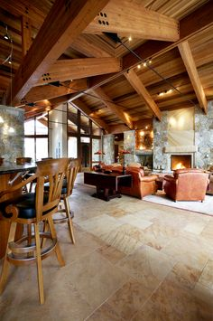 Mountain Rustic Home - Great Room - by KGA Studio Architects, PC.