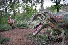 Reconstruction of a realistic scene in prehistory. Two carnivorous dinosaurs hunting