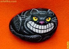 cheshire cat painted rock by rena