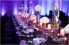 Stunning #floral #centerpieces at this amazing #uplighting #wedding #reception…