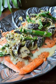 Grilled Salmon With Asparagus, Leeks, And Mushrooms ~ The salmon is being grilled and then accompanied by creamy sauce, leeks, asparagus and mushrooms.