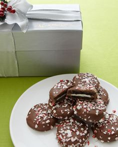 We received these cookies as a gift this week... Neiman Marcus Peppermint Chocolate Cream Cookies---- now I'm going to make some for Christmas!   (Oreo cookies dipped in chocolate, and rolled in crushed peppermint sticks)... YUMMMMMY!!