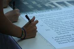 First Year students sign the Honor Code each August during a special ceremony in the May Dell.