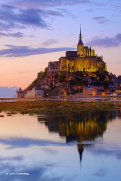 Mont Saint Michel in Normandy, France. You can hear the hoofbeats of knights on horseback echoing through the narrow streets.. The king's fleet with full mast is just barely visible on the horizon. And the sound of monks whispering vespers by candlelight fills the air at sunset.
