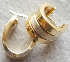 Fabulous 14Kt yellow and white gold triple,  hoop earrings weigh 5 grams on my scale. Pierced earrings have a drop of 3/4 inch and with 3/8 inch wide