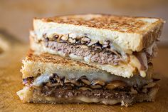 Bistro Style Patty Melt with Havarti Cheese, Caramelized Onions and Sauteed Shitake Mushrooms on Toasted Sour Dough bread