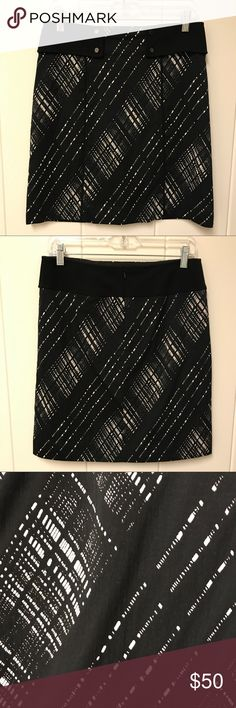 Worth Black and White Career Skirt A-line 2 Black and white plaid print A-line/straight skirt with silver buttons on front.  Back zipper, fully lined.  Excellent preowned condition.  Skirt measures approximately 19.5 inches. Worth Skirts A-Line or Full