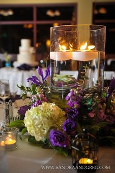 Floating candles in cylinders with flowers surrounding it made for some beautiful table decor.  Emory Conference Center