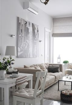 "35 Stylish Neutral Living Room Designs = Rug provides separation between LR area and small dining space in small apartment or condo with ""open"" floor plan. Or - in family room - a table could be used for cards, puzzles or crafts."