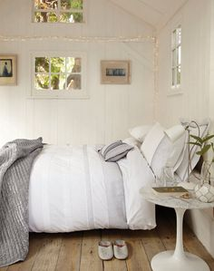 Break up an all white bedroom with a delicate trail of white fairy lights. Hang a subtle line across a wood panelled wall painted in white to add texture, depth, and a cheerful sparkle. All White Bedroom, Dream Bedroom, Dream Rooms, Master Bedroom, Tv Decor, Home Decor, Decor Ideas, Bedroom Styles, Guest Bedrooms