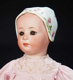 Marks: 7975 Heubach (sunburst) Germany. Comments: Gebruder Heubach,circa 1914,their model known as Stuart. Value Points: rare glass-eyed version of the pouty-faced bonnet doll.
