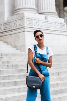 7b3c6559a77 Denim overalls paired with a white tee and black leather crossbody bag from   brahmin Cool