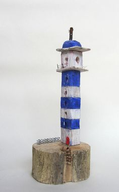 Lighthouse with ladder made from driftwood. Available at www.ardmorepottery.com