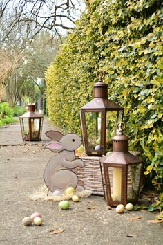 #bevolo Pool House Lanterns with fresh clusters of blooms & decorative eggs.