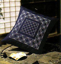 Sashiko cushion. Nice way to combine two patterns.