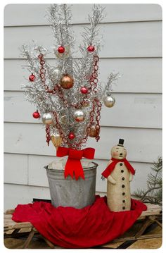 Tree in a pail on a sled