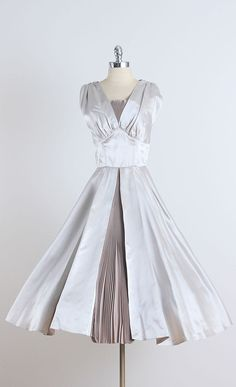 1950s Silver Satin Pleated Party Dress | From a collection of rare vintage evening dresses at https://www.1stdibs.com/fashion/clothing/evening-dresses/