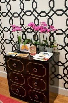 Gina Kates: ohhappyday.com  Dorothy Draper black chest, ivory & black geometric wallpaper and wood ...sherwin williams wallpaper sw8eg5315