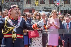 Queen Rania of Jordan, Queen Mathilde of Belgium and King Abdullah II listen to the Jordan concert band outside the Town Hall during a state visit by King Abdullah II of Jordan and Queen Rania Of Jordan on May 19, 2016 in Brugge, Belgium.