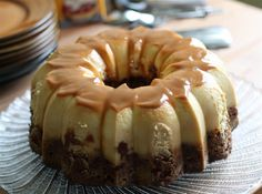 Chocoflan Recipe (retrieved from Food Network) Recipe courtesy Marcela Valladolid, 2009   ingredients 12-cup capacity Bundt pan Softened butter, to coat pan 1/4 cup cajeta or caramel sauce For the cake: 10 tablespoons butter, room temperature 1 cup sugar 1 egg, room temperature 1 3/4 cups all-purpose flour 3/4 teaspoon baking powder 3/4 teaspoon baking soda 1/3 cup cocoa powder 1 1/4 cups buttermilk For the flan: 1 (12-ounce) can evaporated milk 1 (14-ounce) can sweetened condensed milk 4 ou...