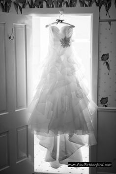Hanging backlit wedding dress Mackinac Island Do It Yourself Wedding planning Photography | Ste Annes Church | City Community Hall photo