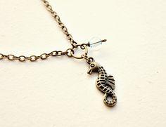 Viv. a seahorse necklace Lemon Kissed