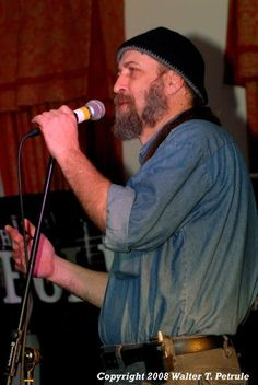 Tim Mason is the featured poet Sunday, October 23, 2016, at the Lizard Lounge