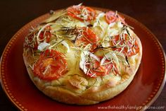 This is a really easy vegan focaccia bread to make using only 4 simple ingredients – roma tomatoes, onions, rosemary, and olive oil. The bread is soft and pillowy.  The olive oil made all the difference in the world and made the crust really golden and crispy.