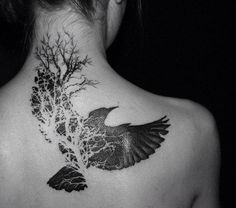 Negative Space Bird Tattoo