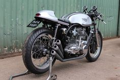 "An absolutely gorgeous ""Triton"" - a Triumph triple inside a custom Norton Manx Featherbed Wideline brazed T45 steel frame. Frankly, I think it highly unlikely that anyone will exceed the standard of craftsmanship that has been lavished on this motorcycle. Whether it's a Savile Row suit, a Purdy shotgun, or this extraordinary bike, no one does elegance better than the British."