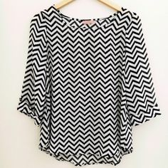 Black and White Chevron Top Light weight chevron top. Nude bra needed under this one, but not too sheer. 3/4 sleeves. NO TRADES OR PAYPAL. Tops Blouses