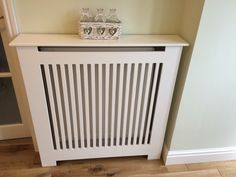 Radiator cover. Hand made by my husband, the front panel is all one piece, he used a router. Made from MDF :)