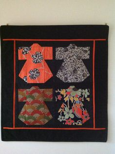 """Small kimono wall hanging that I recently finished, based on a foundation pieced pattern by Julie Wallace in my own layout. The kimono fabrics are """"vintage"""" silk kimono remnants and the black background is also silk ( NOT recommended as it is way too slippery to handle accurately). The borders are standard 100% cottons."""