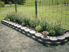 landscaping stones for flower beds | Treated lumberbeds aren't cheap either. The wood raised bed cost about ...