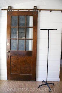wooden barn door. vintage. repurposed. salvage. frosted glass. window. door knob and lock!