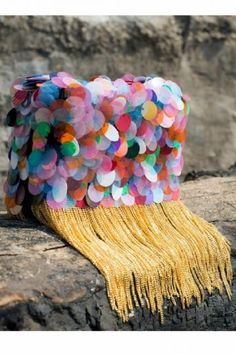 Pep up your wardrobe with candy clutch, featuring the colore sequin embellishments on a box clutch with free falling golden chains which makes it an unconventional design. Flaunt it to grab all the eyeballs!  -www.cooliyo.com