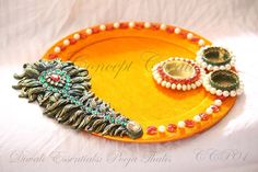 Thermocol craft make peacock model v babji hyderabad for Aarti thali decoration with grains